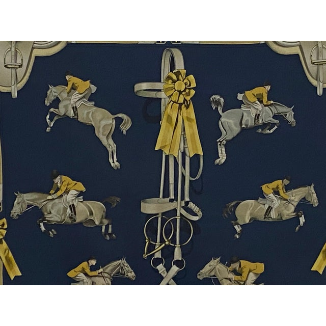 Classic framed Hermes scarf with wonderful equestrian motif in navy blue and gold makes a graphic luxurious piece of art....