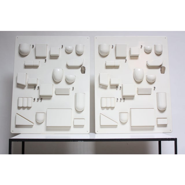Pair of molded plastic Uten.Silos / Wall-Alls designed by Dorothee Maurer-Becker for Design M. These early examples in...