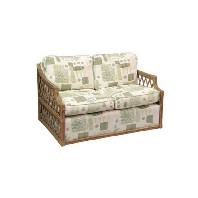 Single Rattan and upholstered settees in the manner of mcguire.