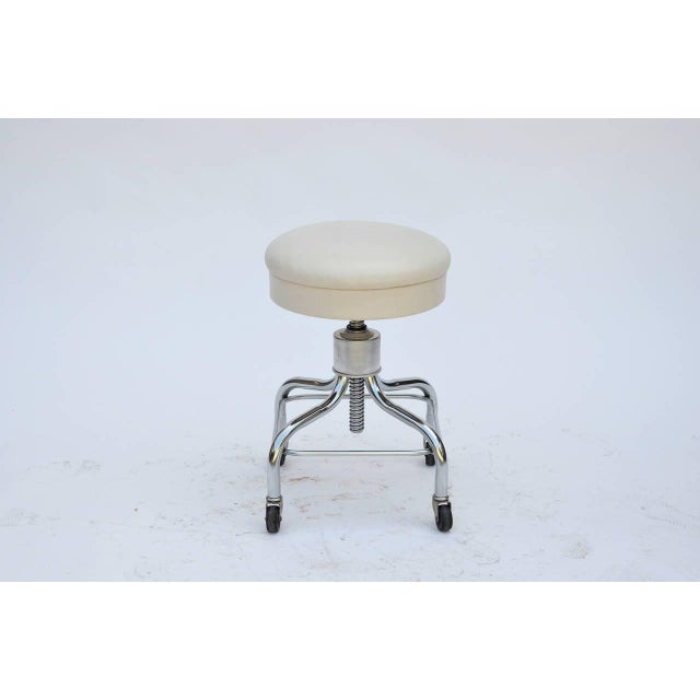 Set of 4 vintage chrome and white leather adjustable rolling stools. Heavy, sturdy and fully functional. Great for an...