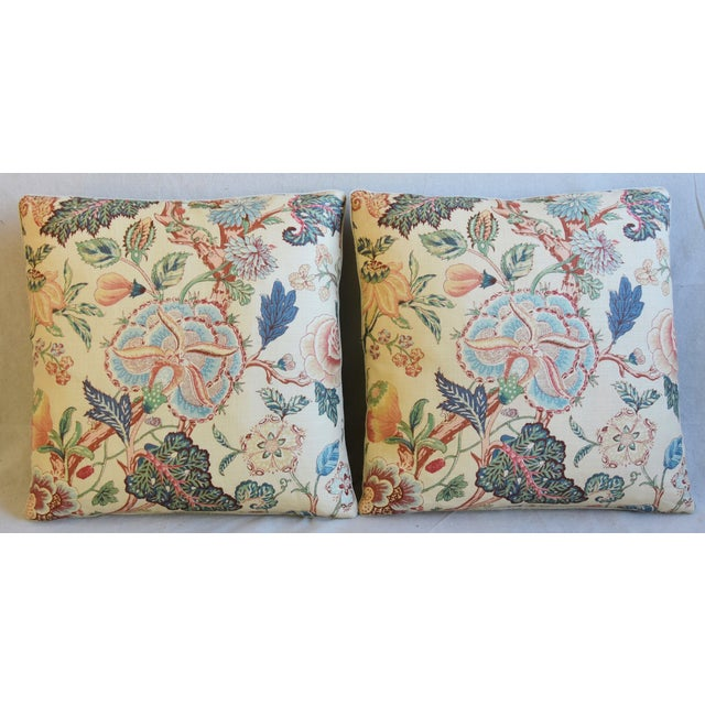 Pair of custom-tailored pillows in vintage hand-printed 100% linen fabric from Travers & Company Fabrics with a floral...