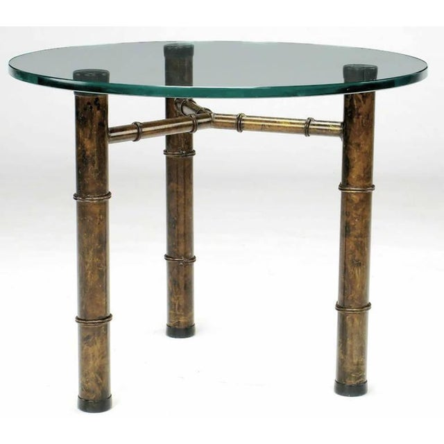Excellent and heavy side table in an aged and stylized bamboo form with three sturdy legs and a connecting Y stretcher....