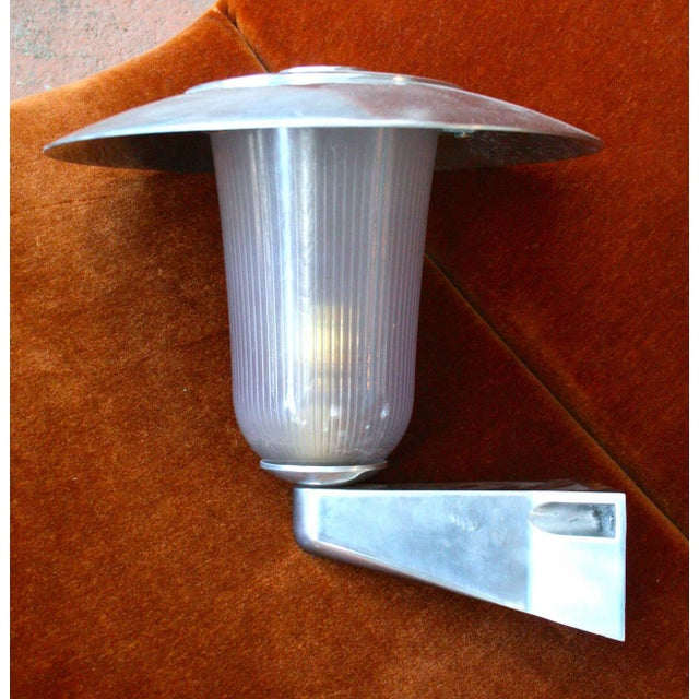 Set of 4 impressive French 1960's wall lights, comprised of cast aluminnum fittings, spun top hood, and holophane glass.