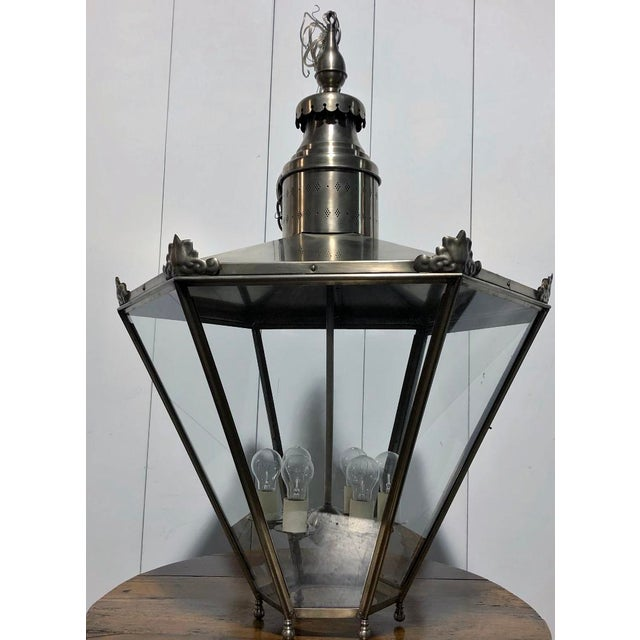 Ann Morris Groves Lantern in Oxidized Brushed Nickel Finish with two feet of chain and canopy. This is great for an Entry...