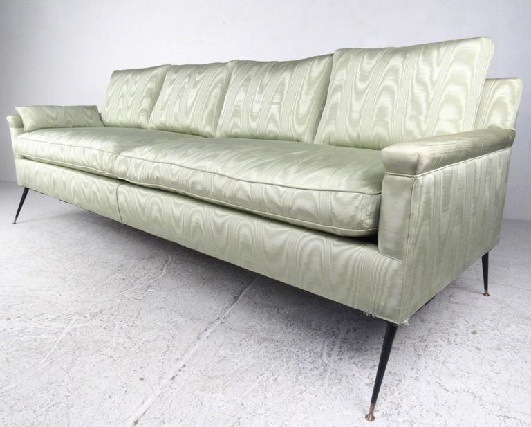 This Four Seat Midcentury Sofa Features Comfortable Two Cushion Design  Complete With Unique Vintage Fabric.