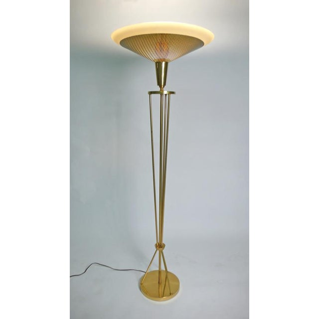 Tall brass Lightolier floor lamp possibly designed by Paavo Tynell. Stunning frosted glass shade with perforated brass...