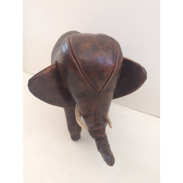 Vintage Dimitri Omersa elephant footstool. In Good Condition for Age with a Beautiful Patina. Minor repair on end of tusks...