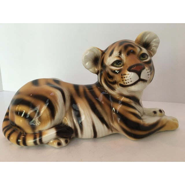 Offering a large statue/figure of a Tiger cub hand painted and made in Italy. This beautiful ceramic piece is painted in...
