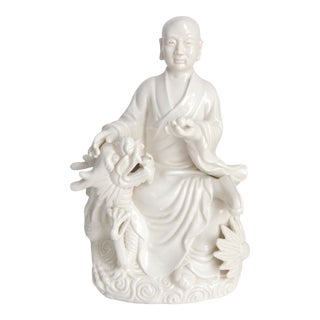Blanc De Chine Monk With Dragon Porcelain Statue For Sale