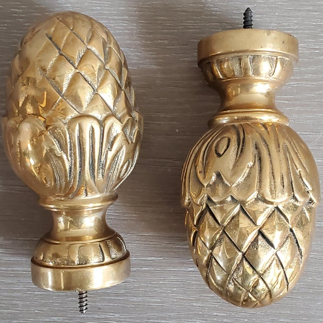 A set of two vintage curtain tie backs/finials in heavy solid brass. They have a welcoming pineapple motif and would...