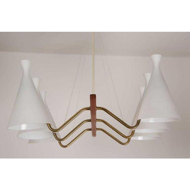 Mid-Century Modern teak and white satin glass six-arm chandelier, Sweden, 1950s. Measures: 23 H x30 W x31 D inches.