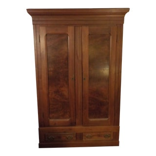 An American Late Victorian Walnut Armoire. For Sale