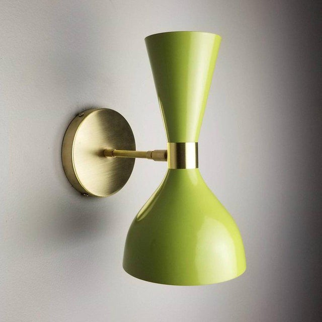 "The Ludo wall sconce or reading light shown in unlacquered bronze and satin ""Sweet Pea"" green enamel fabricated in NYC by..."