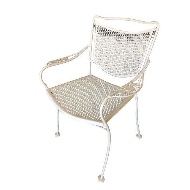 Set of four Russell Woodard designed wireframe outdoor patio chairs with leaf pattern arms and mesh steel seats. Please...