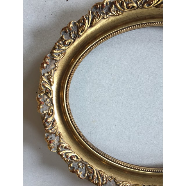 "Pair of vintage oval gold wood frames, 11 x 14"", overall size 14 x 17""."