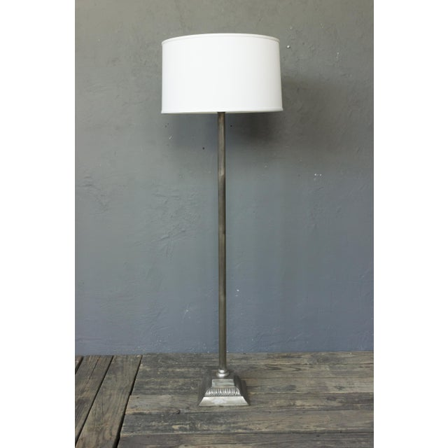 French 1940s silvered bronze and metal floor lamp on a neoclassical style square base. Price includes polishing or plating...