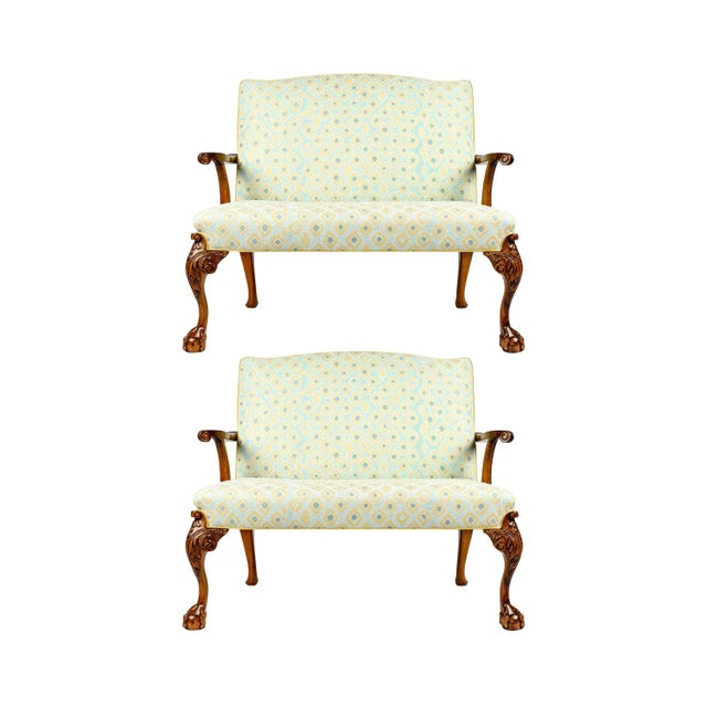 Antique pair of settees with claw foot and camelback re-upholstered in contemporary fabric. Each settee is in excellent...