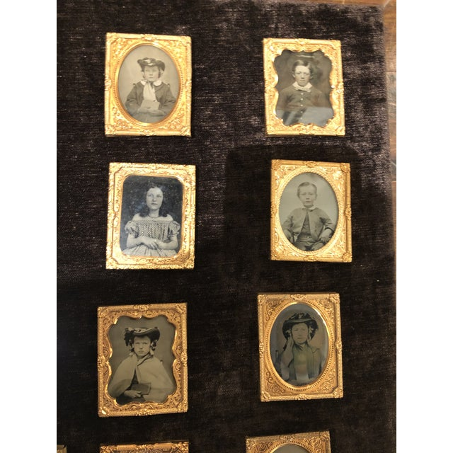 A collection of 20 portraits of school children and their teacher circa 1870 in a acrylic case with a velvet base. The...
