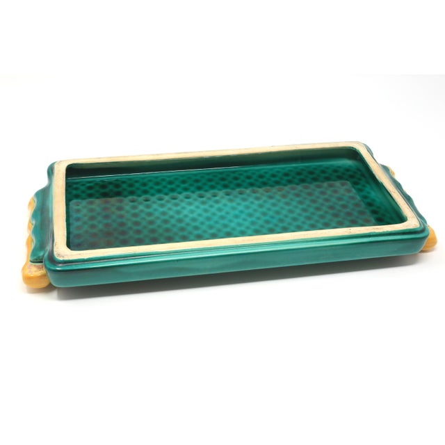 """A vintage, ceramic tray with an embossed geometric pattern and faux bamboo handles. Excellent condition. 1 1/2"""" x 14"""" x 6..."""