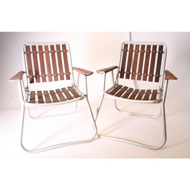 Vintage Mid Century ALUMINUM FOLDING CHAIRS. Redwood slat back & bottoms. Nice brown faux wood metal arms. Rounded legs....