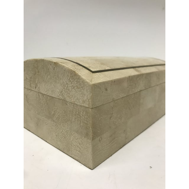 Maitland-Smith tessellated stone box with brass trim and felted interior and bottom table protection .