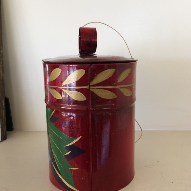 This is an antique hand painted metal tea caddy or biscuit tin. Tole is the common term named for this type of decorative...