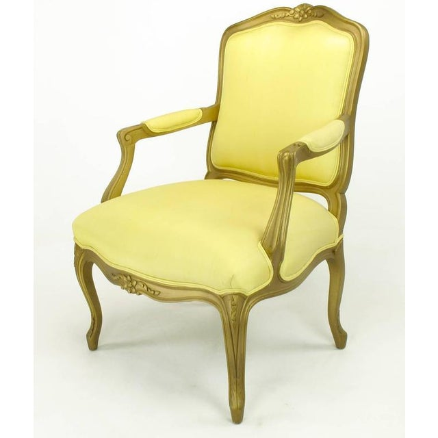 1940s giltwood Louis XV style armchair with saffron silk upholstery. Carved wood frame has been restored and gilt with...