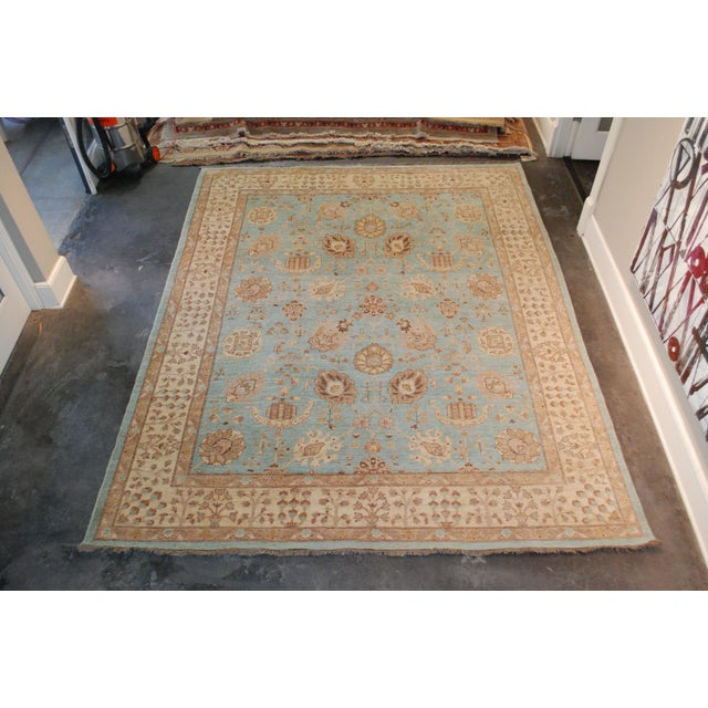 Chobi hand-knotted wool rug. Overall pattern in taupe, beige and brown. Background in shades of blue. Please note the rug...
