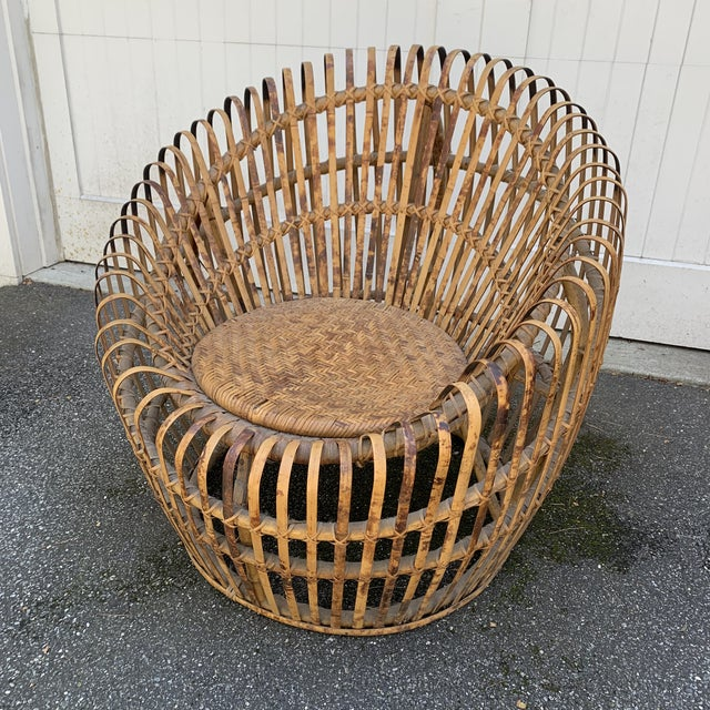 Wonderful vintage Rattan chair in the manner of Franco Albini. Woven seat, bent tortoise colored reed and a very cool...