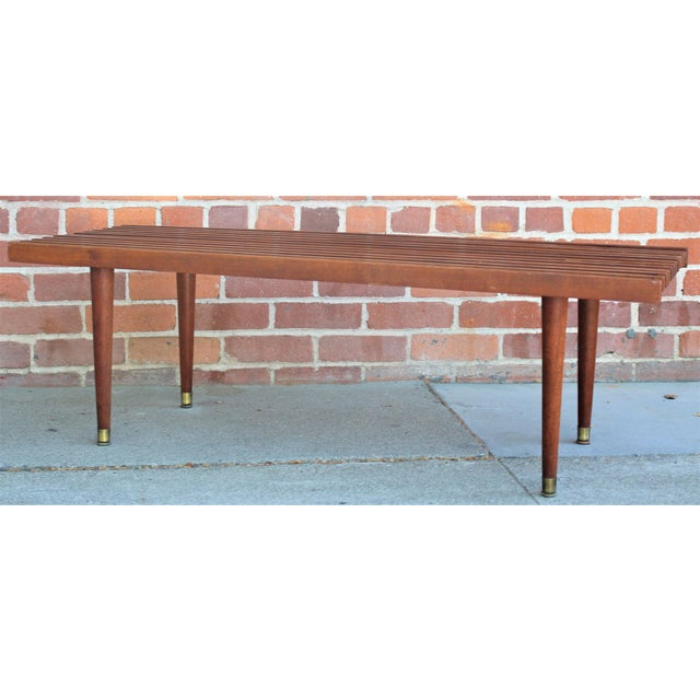 Mid-century modern walnut slat bench or coffee table. A lovely example of mid-century design, in good condition, with...