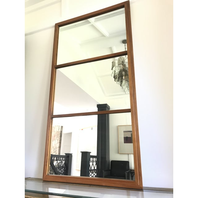 Extremely large and heavy solid walnut mirror with a minimalist geometric design. Manufactured by the Hart Mirror Plate...