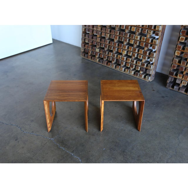 Cube Nesting Tables by Peter Hvidt for Richard Nissen. A pair of solid teak side tables with box cut finger joints and...