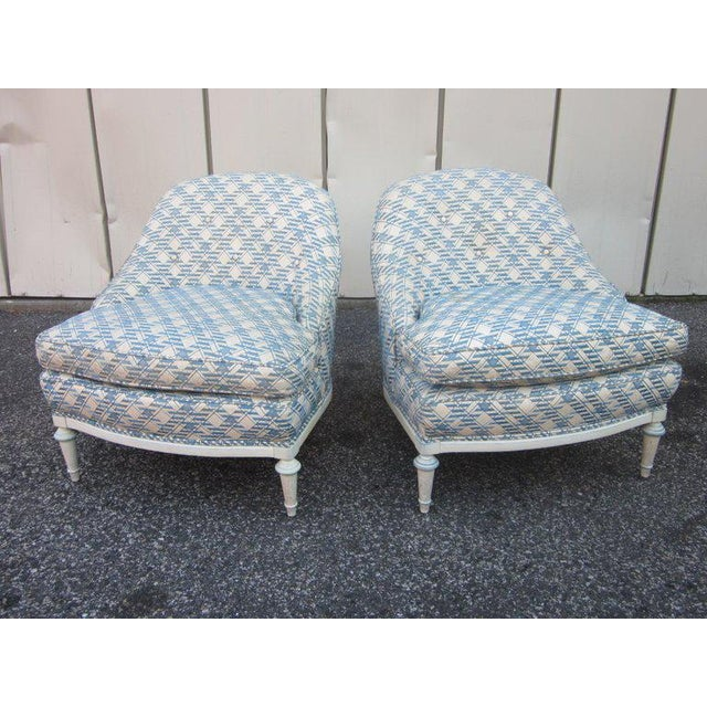 Pair of French fauteuils / slipper chairs which are upholstered in a leatherette material with a painted wood base.