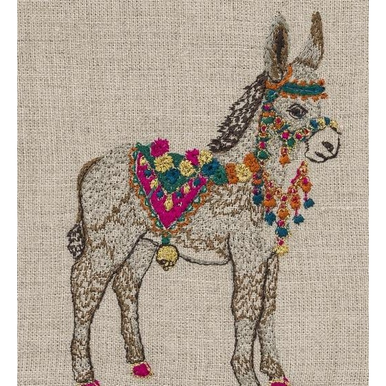 Covered in flowers and tassels, Frances the donkey proudly pulls her ornate cart through town. She helps her fellow...