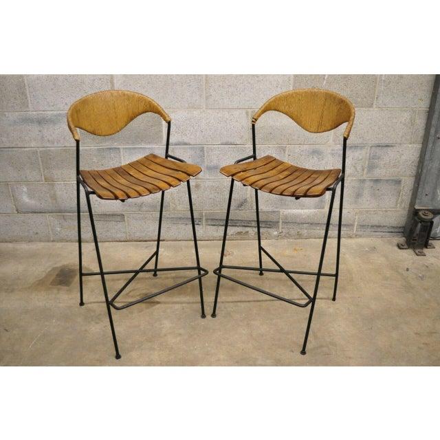 Mid Century Modern Arthur Umanoff Wrought Iron and Rattan Bar and Bar Stools. Item features wrought iron frames, wood slat...