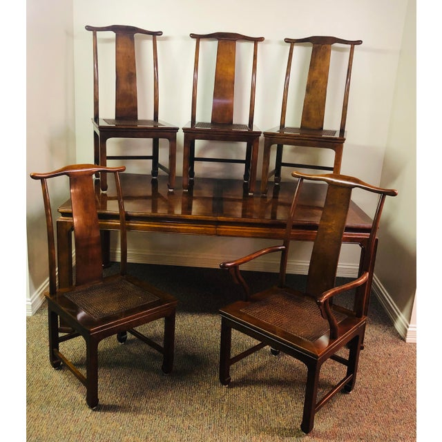 Classic mahogany dining table. 4 chairs, 1 captain chair (a bit wobbly handles/armrests that may need attention, second...