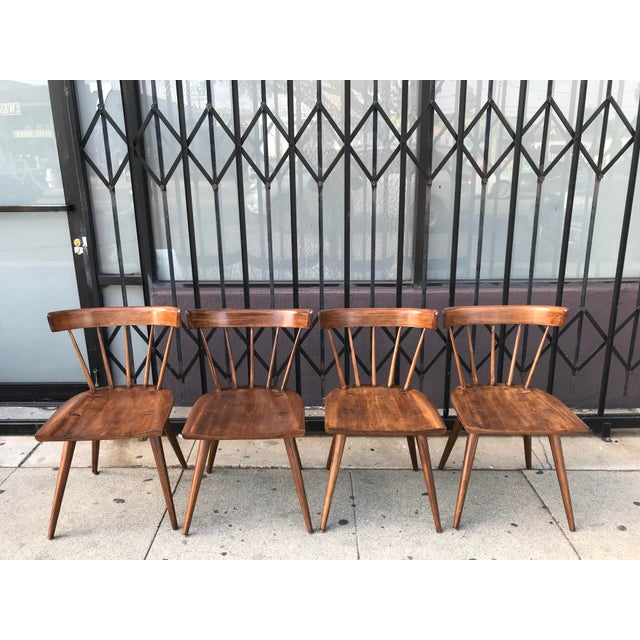 High quality American made 1950's solid maple set of 4, spindle back chairs. ~ Designed by Paul McCobb for the Planner...