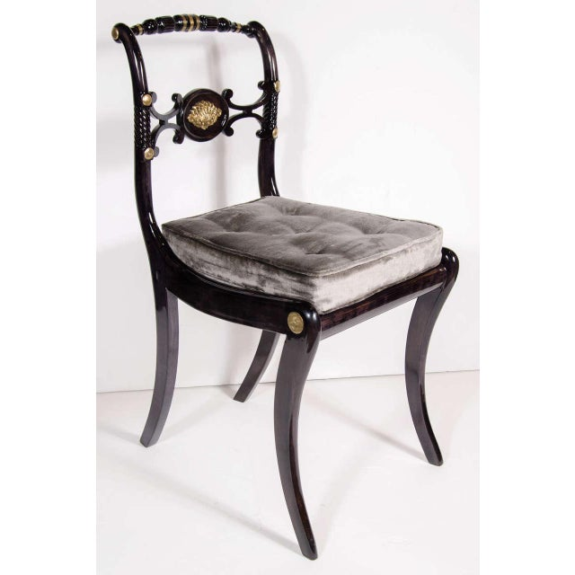 This stunning chair was crafted from ebonized walnut. It features a saber leg design and gilt accents, and hand carved...