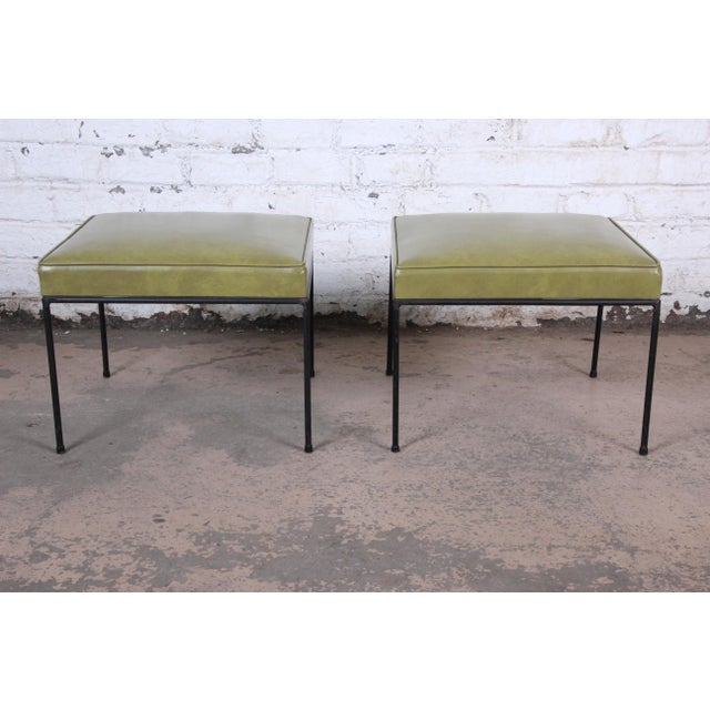 A stylish pair of matching mid-century modern stools or ottomans designed by Paul McCobb. The stools feature nice black...
