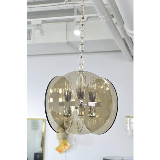 """A smoked glass chandelier in the manner of Fontana Arte, with three glass circles each with a diameter of 10"""". Six sockets..."""