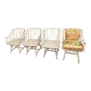 Set of Four Vintage Hollywood Regency Mid Century Rattan and Bamboo Swivel Dining Chairs on Wheels in the Manner of Ficks Reed or Brown Jordan For Sale