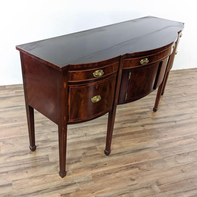 National Trust for Historic Preservation Reproduction (circa 1810). Flame mahogany sideboard, with inlay, has a felt lined...