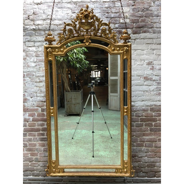 19th century mirror with mirror borders in the style of Louis XVI, gold leaf gilded with its original mirror-glass,...
