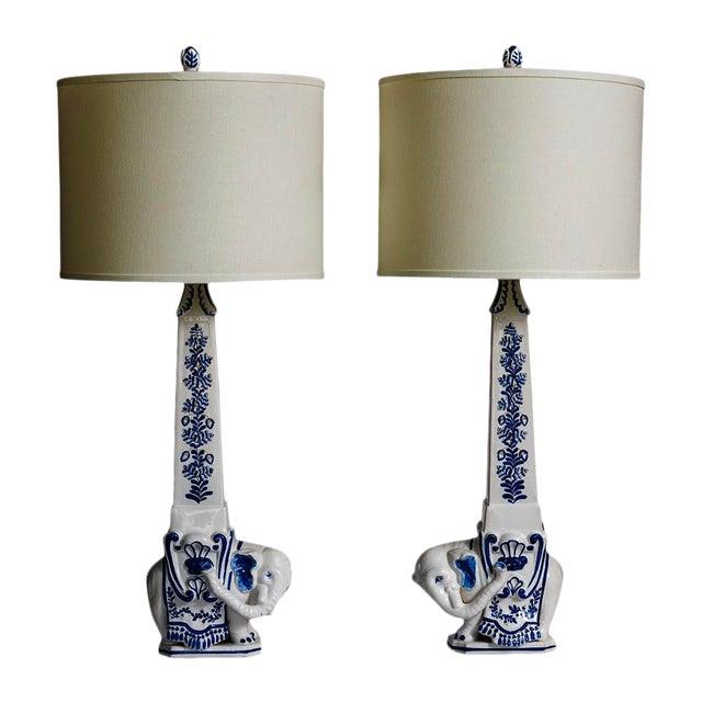 Italian Glazed Terra Cotta Blue & White Elephant Obelisks, A-Pair For Sale