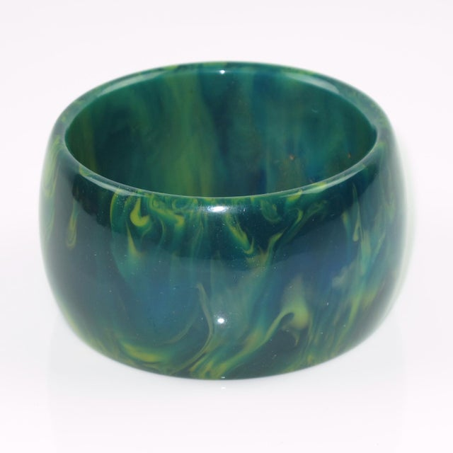 Gorgeous blue-moon marble Bakelite bracelet bangle. Oversized wide domed shape. Intense blue marble tone with green and...