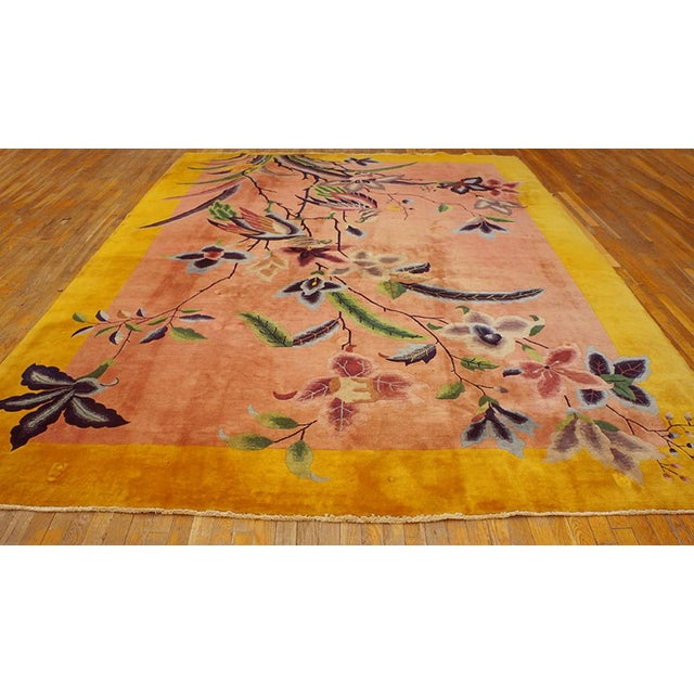 "This is a Chinese art wool rug from China 1920. The size is 8'9""x11'6"". The colors are yellow, peach, pink, green, gray,..."