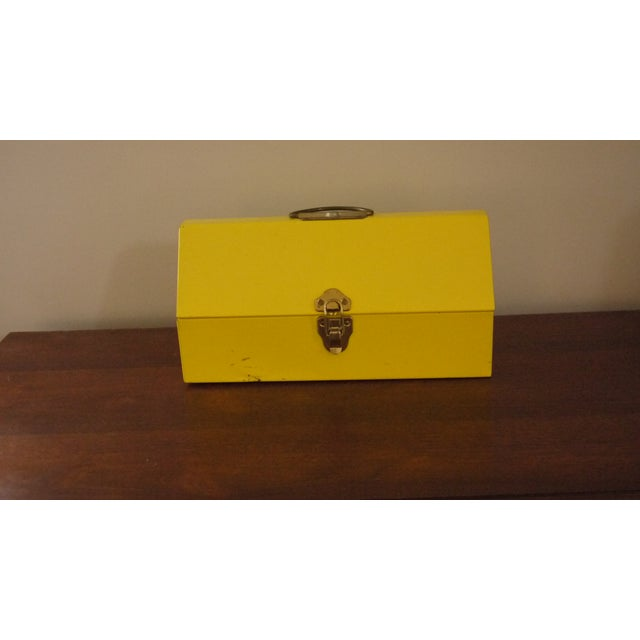 This bright yellow toolbox is the perfect storage space for tools or crafts.