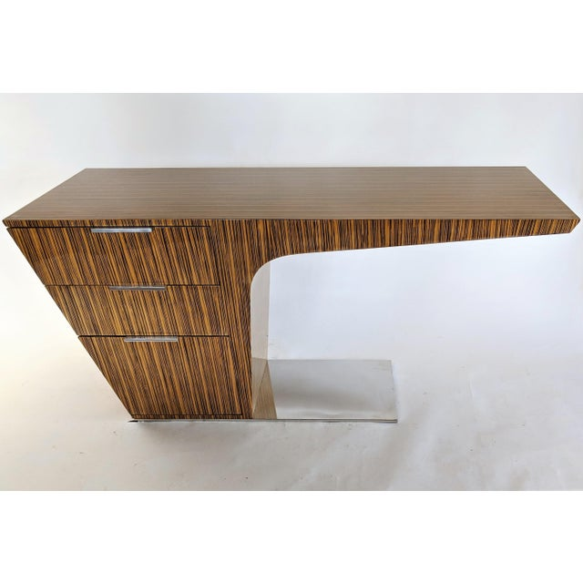 Gorgeous highly lacquered zebra wood veneer with chrome pulls and base plate. Contemporary modern with Cantilever design....