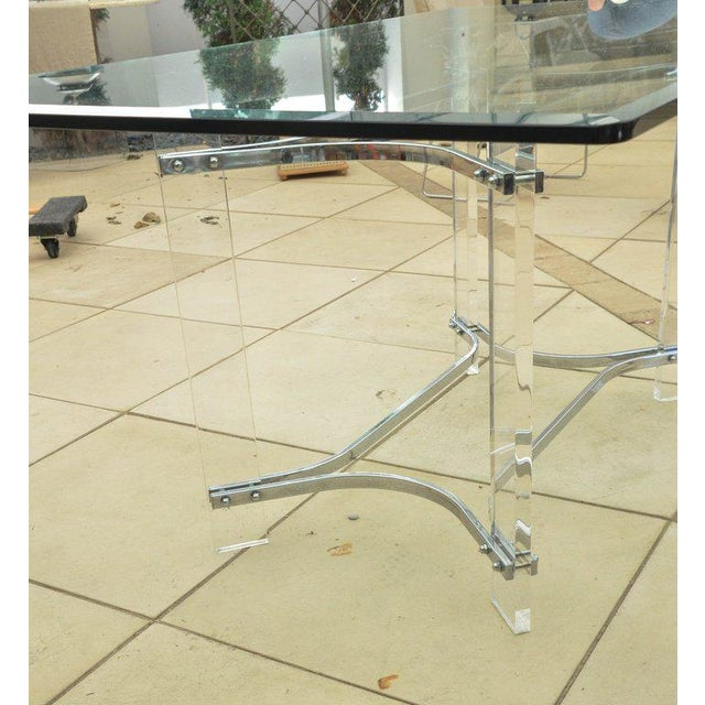 Mid-Century dining table by Charles Hollis Jones. The base is Lucite with chrome-plated metal supports. The glass top is...