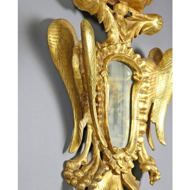Each depicting two eagles beneath a crown, possibly Austrian or Russian.